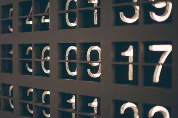 assorted black tiles with numbers on them lit from behind