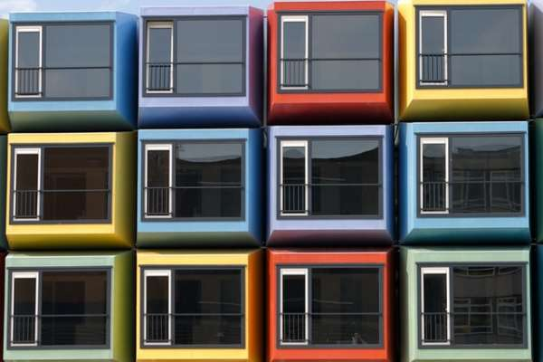 A grid of colorful box apartments